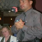 Panelist Sgt. Danny Camargo answers a question