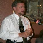 Panelist Investigator Todd Moderson offers remarks
