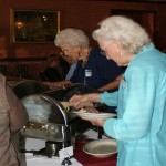 LWV members help themselves to the buffet at Sergio's