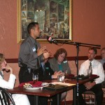 Panelist Sgt. Danny Camargo (standing), Seminole County Sheriff's Office, addresses luncheon guests