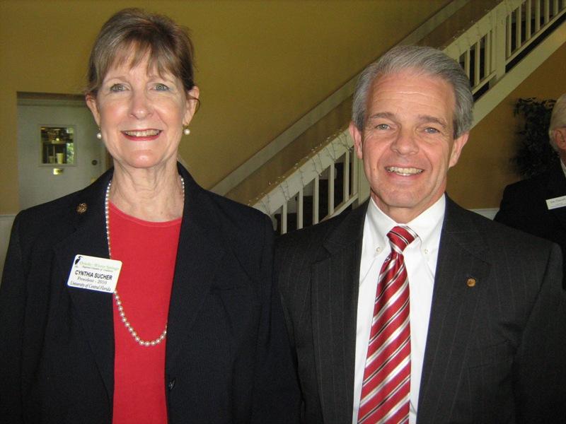Cynthia Sucher, chamber president with speaker Joel L. Hartman,  University of Central Florida (photo - CMF Public Media)