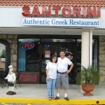 Zhanetta (left) and husband Petraq Strakosha in front of their Oviedo restaurant - Santorini's  (Photo - CMF Public Media)