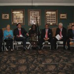 Candidates on stage at the forum sponsored by the Oviedo Winter Springs Regional Chamber of Commerce. From left, the candidates are Paul Sladek, Cindy Drago, Robert Thrift, Judith Delores Smith, Darrell Lopez, Matthew Schwartz, and Robert Pollack, Jr. (photo - CMF Public Media)