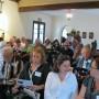 Casa Feliz audience prepares for lecture (photo - CMF Public Media)